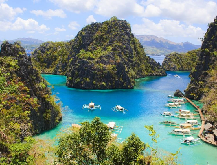 Appreciate the spectacular scenery of Coron Bay.